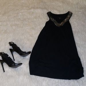 Black dress with detailed neckline